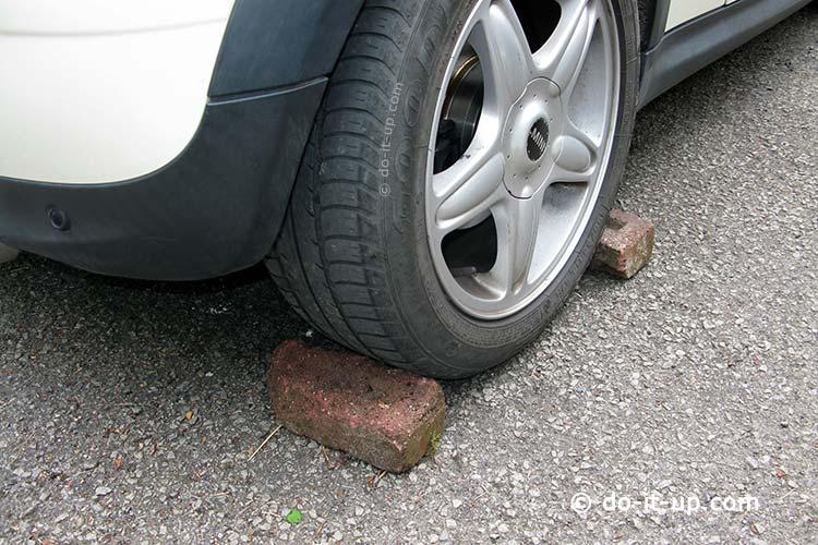 Jacking Up a Vehicle - Chocking the Wheel