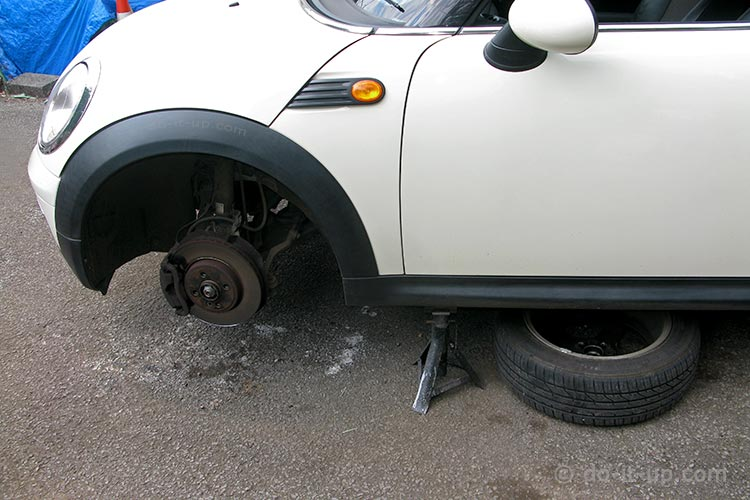 Jacking Up a Vehicle - Using the Wheel for Additional Safety