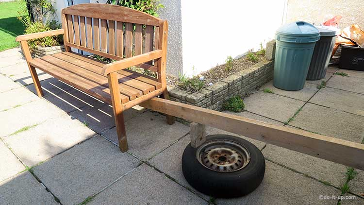 Breaking a Tyre Bead Using Two Pieces of Wood and Someone Sat on the Bench