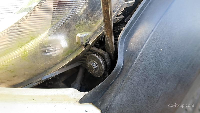 The Seized Mini Headlight Bolt (After Loosening - Gently Levering it Out)